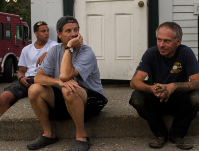 three on steps of firehouse