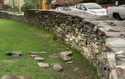 wall curve law stones on lawn