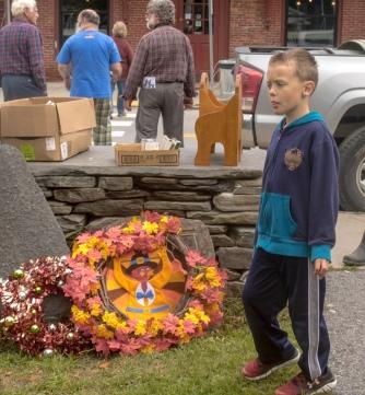boy next to thanksgiving wreath