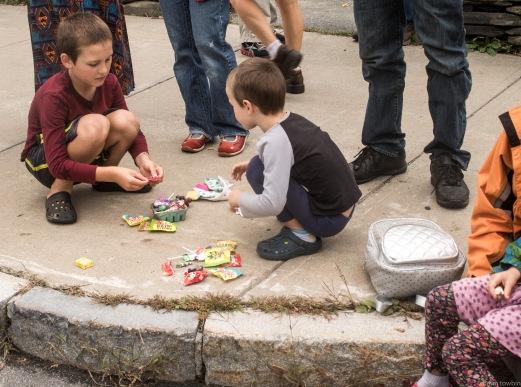boys dividing candy on corner