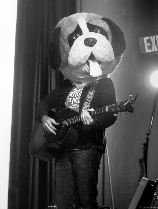 guitarist with dog head
