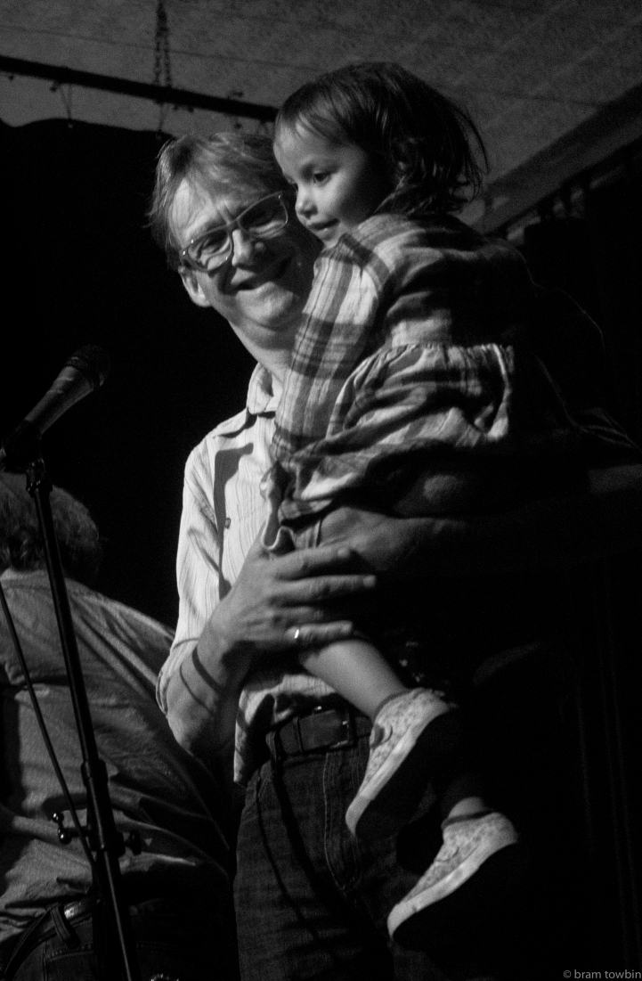 holding child onstage