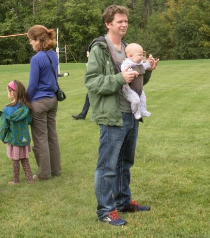 man holding baby