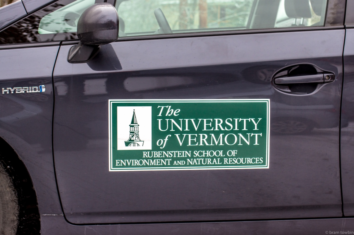 sign uvm side of car