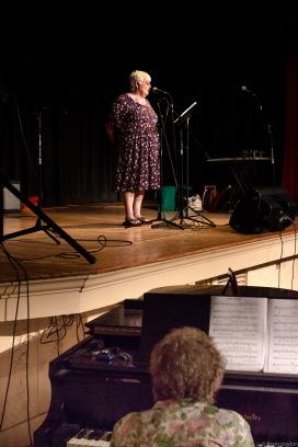 ms. c singing wide shot