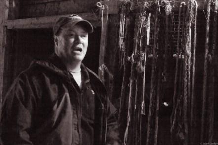 dave speaking in front in barn