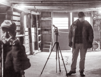 father son in barn