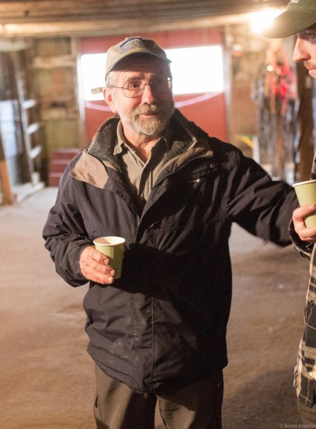 gary having coffee in barn