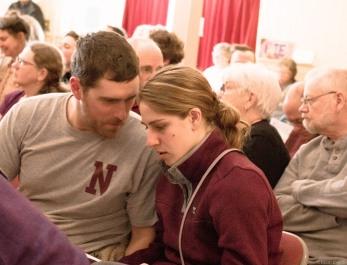 couple talking in crowd