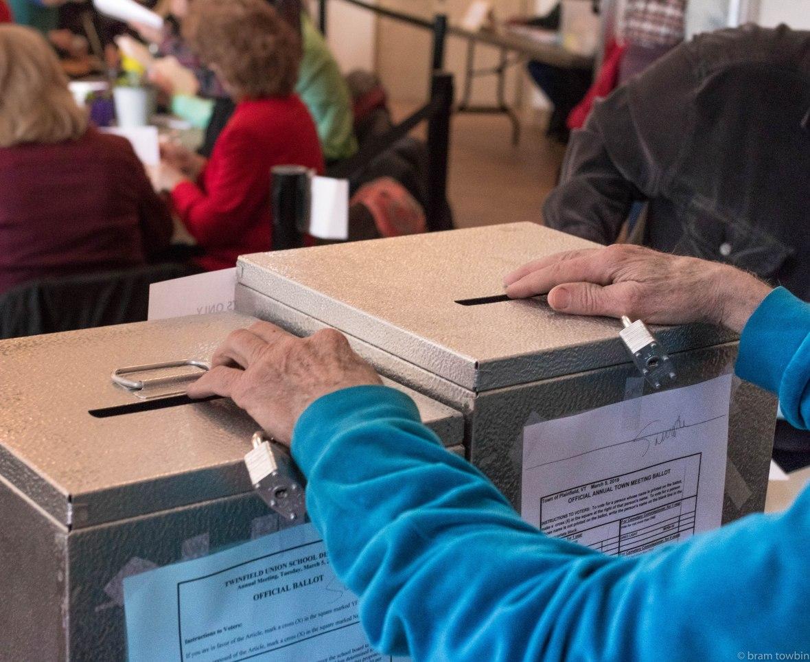 holding ballot boxes