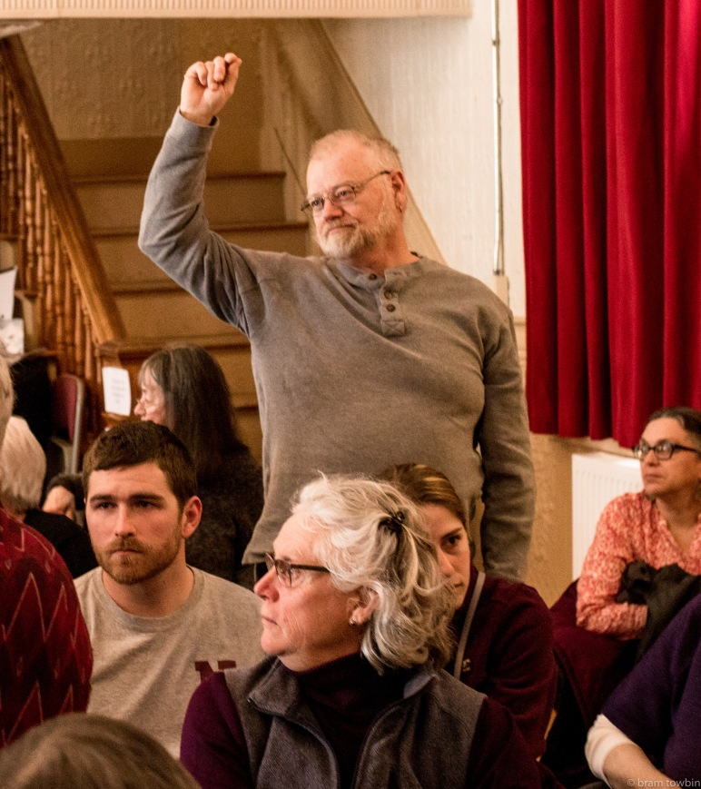 man voting in crowd